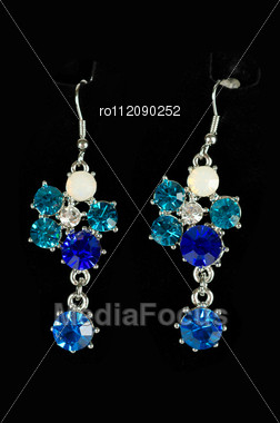 Beautiful Earrings With Colorful Gems On Black Background Stock Photo