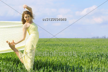 Beautiful Flexible Young Woman Wrapped In Yellow Cloth Stock Photo