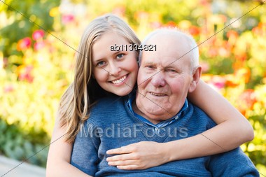 Beautiful Granddaughter Visiting Her Elderly Kind Grandfather Stock Photo