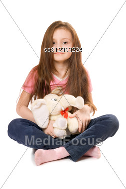 Beautiful Little Girl With A Teddy Elephant Stock Photo