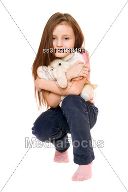 Beautiful Little Girl With A Teddy Elephant. Stock Photo