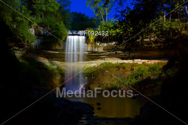 Beautiful Minneapolis Waterfall Under The Lights Early In The Morning Stock Photo