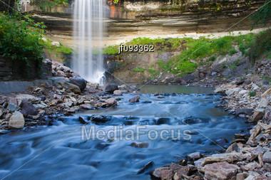 Beautiful Minnehaha Creek Waterfall And Downstream River Stock Photo
