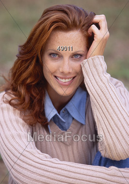 Beautiful Red Haired Woman with Great Smile Stock Photo