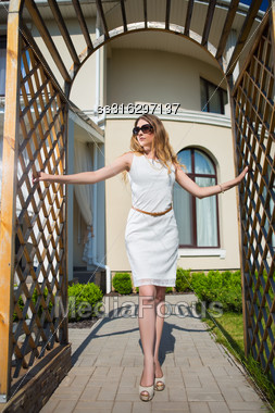 Beautiful Slim Blond Woman Posing In Archway Outdoors Stock Photo