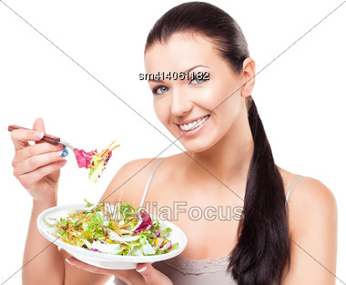 Beautiful Smiling Young Woman Eating Green Salad With Fork Stock Photo