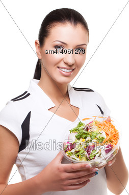 Beautiful Sporty Healthy Woman With Mixed Salad Over White Background Stock Photo