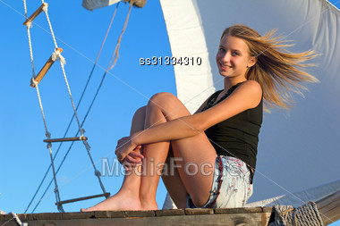 Beautiful Teen Girl Sitting At Stern Of The Ship Stock Photo