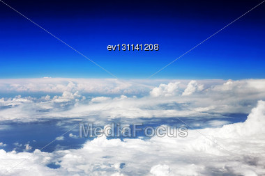 Beautiful View Above The Earth At The Clouds Below Stock Photo