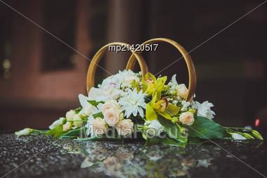 Beautiful Wedding Rings On The Car In The Rain Stock Photo