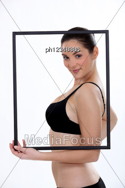 Beautiful Woman In Underwear Behind A Frame Stock Photo