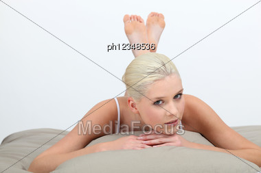 Beautiful Woman Relaxing In Bed Stock Photo