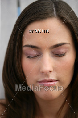 Beautiful Woman With Her Eyes Closed Stock Photo