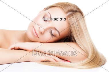 Beautiful Young Blond Girl With Natural Make-up Leaning On Her Arms Stock Photo