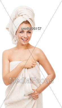 Beautiful Young Blond Girl With Natural Make-up Wearing Towel In Her Head And Holding Towel Aronf Her Body Stock Photo