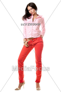 Beautiful Young Brunette In Red Jeans. Stock Photo