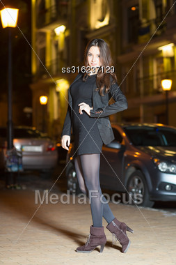 Beautiful Young Brunette Wearing Black Clothes Posing In The Evening Stock Photo