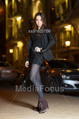 Beautiful Young Brunette Wearing Black Clothes Posing Near The Road Stock Photo