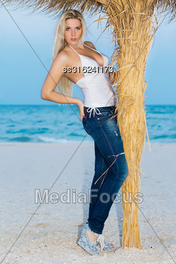 Beautiful Young Caucasian Woman Posing On The Beach Stock Photo