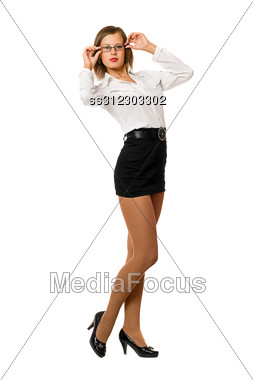 Beautiful Young Woman In A Black Skirt And White Shirt Stock Photo