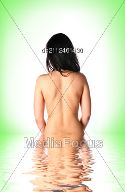 Beautiful Young Woman Half In Water Against Light Green Stock Photo