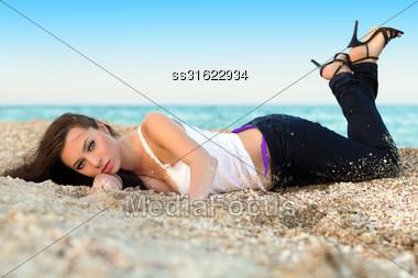 Beautiful Young Woman Lying On The Beach Stock Photo