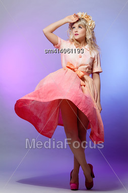 Beautiful Young Woman Standing In A Dress Stock Photo