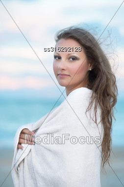 Beautiful Young Woman In Towel Posing On The Beach Stock Photo