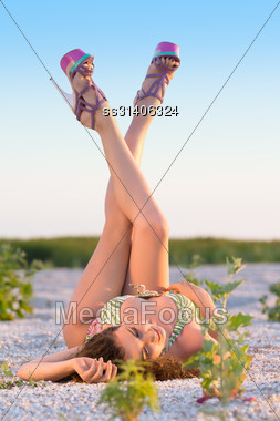 Beautiful Young Woman Wearing Trendy Heels Posing With Raised Legs Stock Photo