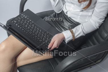 Beautiful Young Woman Working With A Laptop In The Room On Lap Closeup Stock Photo