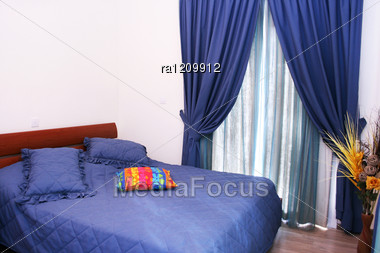 bedroom with blue curtains and bedspread  stock photo ra, Bedroom decor