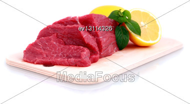 Beef Steak On Meat Hardboard With Green Leaf And Lemon. Isolated Stock Photo