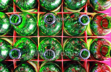 Beer Bottles Of Green Glass. Empty Green Bottlse In Box. Top View Stock Photo