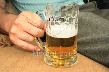 Beer In Man Hand Stock Photo