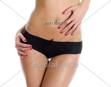 Belly And Legs Of Beautiful Woman In Black Panties. Isolated On White Stock Photo