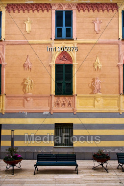Bench Green Wood Venetian Blind Bush Plant And A Pink Yellow Red Wall In The Centre Moneglia Italy Stock Photo