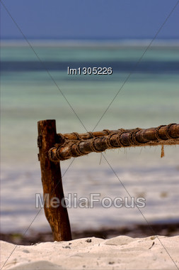 Bench Rope Beach And Sea In Zanzibar Coastline Stock Photo