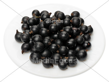 Berries Of A Black Currant On A White Plate On A White Background, Isolated Stock Photo