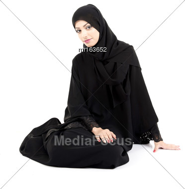 Beutiful Arab Woman Sitting On The Floor Isolated On White Background Stock Photo