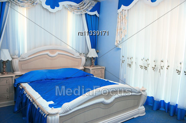 Beutiful Blue Bedroom With Luxurious Decorations Stock Photo