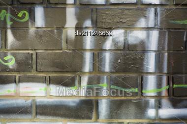 Bg Of Brick Wall With Graffiti Stock Photo