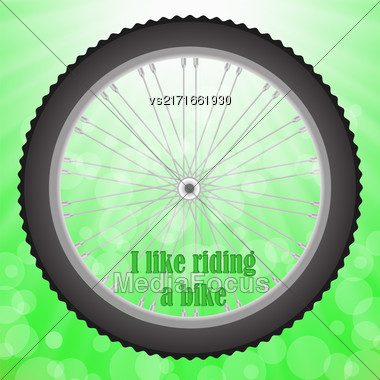 Bicycle Wheel Isolated On Summer Green Blurred Background Stock Photo