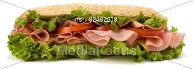Big Appetizing Fast Food Baguette Sandwich With Lettuce, Tomato, Smoked Ham And Cheese Isolated On White Background. Junk Food Subway Stock Photo