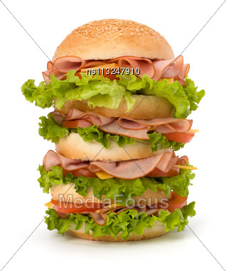 Big Appetizing Fast Food Sandwich With Lettuce, Tomato, Smoked Ham And Cheese Isolated On White Background. Junk Food Hamburger Stock Photo