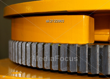Big Cogwheel On The Mechanism Of Yellow Color Stock Photo