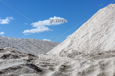 Big Pile Of Freshly Mined Salt, Set Against A Blue Sky Stock Photo