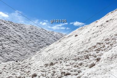 Big Pile Of Freshly Mined Salt, Set Against A Blue Sky Stock Photo