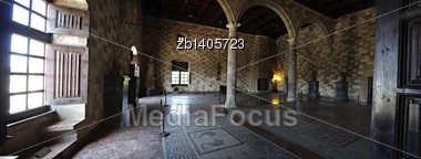Big Room With Fire Place, Mosaics, Columns And Arcs Inside Medieval Castle Stock Photo