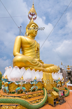 Big Statue Of Golden Buddha In Tiger Temple, Krabi Province, Thailand Stock Photo