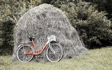 Bike Stands Against A Haystack. Rural Landscape Stock Photo